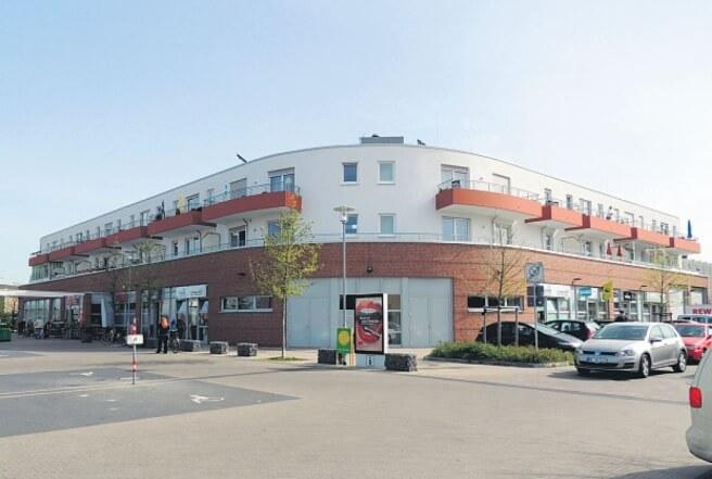 Neubau eines Wohn- und Geschäftshauses mit 20 Wohnungen, Einzelhandel und Büroräume